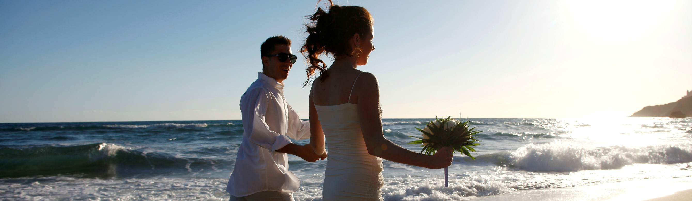 _ lti_Louis_Grand_-_Wedding_couple_by_the_sea_2.jpg