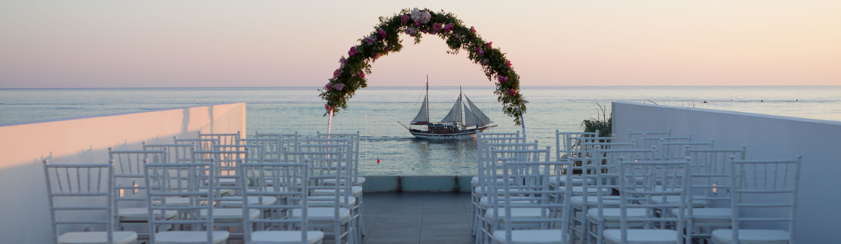 almyra_sunset_wedding_ceremony_setup.jpg
